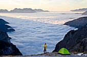 Man & tent above clouds, Italy, Italia\nTrentino-Alto Adige, South Tyrol\nBolzano district\nAlta Pusteria, Hochpustertal\nDolomiti di Sesto Natural Park