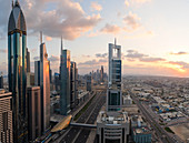Elevated view over the modern Skyscrapers along Sheikh Zayed Road looking towards the Burj Kalifa, Dubai, United Arab Emirates