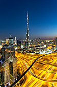 Elevated view at dusk over Downtown & Sheikh Zayed Road looking towards the Burj Kalifa, Dubai, United Arab Emirates