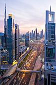 Metro station at Sheikh Zayed Road with the Burj Khalifa in the background,  Dubai, United Arab Emirates
