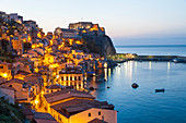 Town View at dusk, with Castello Ruffo, Scilla, Calabria, Italy