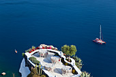 Outdoor dining area, Oia, Santorini, Cyclades islands, Greece