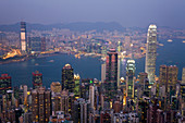 View from Victoria Peak across harbour at dusk, Hong Kong, China