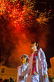 Fireworks and giant puppets dressed as a bride and groom during a Calenda, a procession through the streets of downtown Oaxaca, celebrating a wedding in the city of Oaxaca de Juarez, Oaxaca, Mexico.