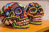 Skulls covered with glass beads on display in an art gallery in Oaxaca City, Mexico.