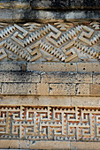 Details of the fretwork on the walls of courtyard in the main building, called the Palace or the Grand Hall of Columns, at the Mitla Mesoamerican archaeological site (UNESCO World Heritage Site) in Mitla, a small town in the Valley of Oaxaca, southern Mexico.
