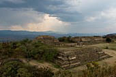 View of the Grand Plaza towards the Gallery of los Danzantes (dancers) from the South Platform of Monte Alban (UNESCO World Heritage Site), which is a large pre-Columbian archaeological site in the Valley of Oaxaca region, Oaxaca, Mexico.