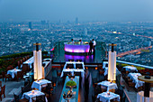 Bangkok, Thailand Stylish outdoor bar at the top of a skyscraper the in evening
