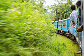 Train journey from Kandy up to southern highlands and tea estates, Sri Lanka