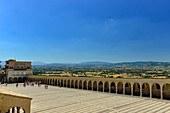 View from the Basilica of San Francesco over the courtyard and the vast hinterland, Assisi, Italy