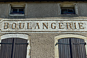 Old lettering Boulangerie on the facade of a house in Liverdun on the Moselle, France