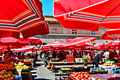 The busy fruit market with red parasols in Zagreb, Croatia