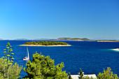 A sailing boat in the blue water between the Adriatic islands, Primosten, Dalmatia, Croatia