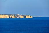 Rocky coast on the blue Atlantic, near Odeceixe, Algarve, Portugal