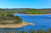 Reservoir in a hilly landscape near Marmelete, Algarve, Portugal