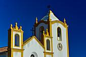 Colorful church against a deep blue sky, Luz, Algarve, Portugal