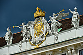 Angels and coats of arms as decoration of a historical roof on an Art Nouveau house, Vienna, Austria