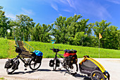 Fully packed travel bicycles with dog trailers on the Danube Cycle Path Euro Velo 6, Vienna, Austria