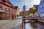 Hirschgasse and Memminger Ach with a view of Frauenkirche in Memmingen, Bavaria, Germany