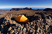 Dream campsite on the summit of the Piton des Neiges, 3070 m., Highest mountain on La Réunion and the Indian Ocean. on the horizon the Gros Morne massif.