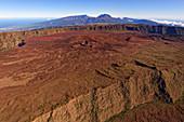 The huge plateau of Plaine des Sables is reminiscent of Mars. On the horizon the Piton des Neiges (3070 m.).