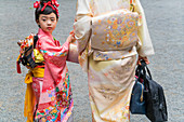 Mother and daughter in traditional Japanese dress, Tokyo, Japan