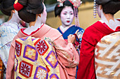 Women dressed in traditional geisha dress, Kyoto, Japan