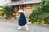 Shinto monk walking along the street in Kyoto, Japan