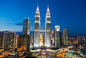 Petronas Towers and skyline at dusk, Kuala Lumpur, Malaysia