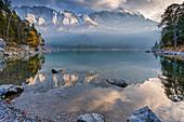 Autumn afternoon at the Eibsee, Grainau, Werdenfelser Land; Upper Bavaria, Bavaria, Germany, Europe