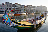 Colorful Moliceiros boats in Aveiro.