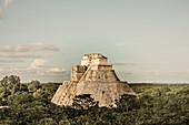 Uxmal, Yucatan, Mexico - October 13, 2017: The Pyramid of the Magician (Pirámide del Mago) towering in the Maya City of Uxmal, Mexico