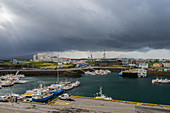 Storm cloud over Stykkiksholmur harbour. Iceland.