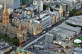 MELBOURNE - APR 14, 2014:Aerial view of Flinders Street in Melbourne city center at dusk. Melbourne is Victoria's capital city and the business, administrative, cultural and recreational hub of the state.