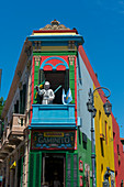 A colorful house with a statue of the pope in La Boca, a Buenos Aires neighborhood famed for its colorful houses and tango, a major tourist attraction in Buenos Aires, Argentina.