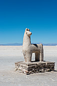 A llama statue carved out of salt at Salinas Grandes a salt pan in the Andes Mountains - is situated on an altitude of 3.450 meters on the border of the provinces of Salta and Jujuy, Argentina.