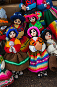 Street scene with souvenir dolls made out of colorful woven fabrics for sale in Humahuaca, a city in the valley of Quebrada de Humahuaca, Andes Mountains near Purmamarca, Jujuy Province, Argentina.