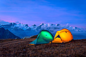 Sunset with lit tents on top of Facciabella, Monte Rosa on background,Val d'Ayas, Aosta Valley, Italy, Europe