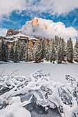 the small lake of Bain de Dones after the snowfall, in the background the Tofana di Rozes, Dolomites, Cortina d'Ampezzo, Belluno, Veneto, Italy
