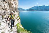 "Pregasina, Riva del Garda, Lake Garda, Trento province, Trentino Alto Adige, Italy, Europe. Climbers on the ""Via dei Contrabbandieri"" (also named Via Torti) high above the Garda Lake"