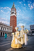 Typical mask of Carnival of Venice with the bell tower of St. Mark in the background, Venice, Veneto, Italy