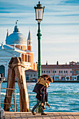 Couple walking at Zattere, Dorsoduro, Venice, Veneto, Italy