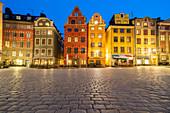 Illuminated medieval townhouses at dusk, Stortorget Square, Gamla Stan, Stockholm, Sweden