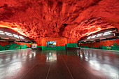 Solna Centrum metro station decorated with red and green ceiling artwork, depicts environmental and social problems, Stockholm, Sweden