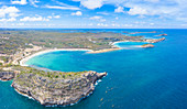 Aerial panoramic of cliffs surrounding Half Moon Bay and Exchange Bay, Antigua, Caribbean, West Indies