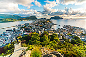Tourist snaps photos of Alesund from Byrampen viewpoint, More og Romsdal county, Norway