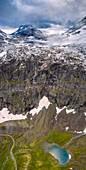 Aerial panoramic of Hornvatnet lake and the rocky mountains of Venjesdalen valley, Andalsnes, More og Romsdal county, Norway