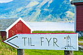 Wood signage showing directions for Hogsteinen Lighthouse, Godoya Island, Alesund, More og Romsdal County, Norway