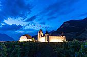 Aigle Castle illuminated at dusk, canton of Vaud, Switzerland