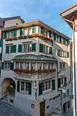 Flowers on the decorated buildings in Lindenhof area, Old Town of Zurich, Switzerland